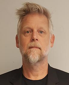 Michael Murphy undervisar inom fastighetsekonomi